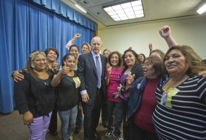 September 26, 2013 Domestic workers and Governor Brown cheering after he signed AB 241 into law.